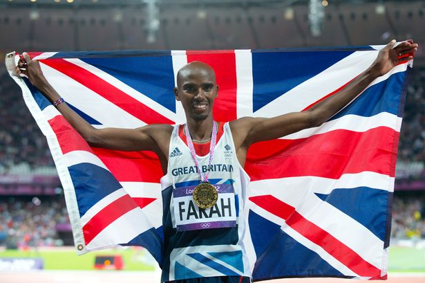 Great Britain's Mo Farah wins gold in the 10,000M at the Olympic stadium during the London 2012-1233657