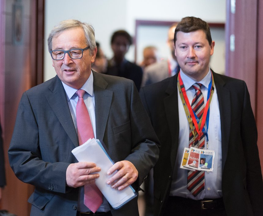 Brussels, Belgium, June 11, 2015. -- President of the European Commission Jean-Claude Juncker arrives for the second day of an EU-Latin America Summit. Back right is Martin Selmayr, cabinet chief. (Photo by Thierry Tronnel/Corbis via Getty Images)